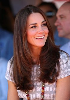 Catherine, Duchess of Cambridge, aka Kate Middleton, visiting the Uluru Cultural Center, Yulara, Australia. She is wearing her Hobbs Wessex dress, Pied a Terre Imperias wedges, and Double Leaf earrings by artisan Catherine Zoraida. 4/22/14