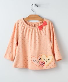 What a wonderful way to symbolize the spirit of togetherness with three hearts as one. Our You + Me flouncy top is a new design from the Hallmark Baby art team and makes a simple idea a beautiful illustration. This new Valentine's Day top is a little dressy, but is still great for play dates too. It features a wonderful polkadot pattern, a partially-gathered neckline and an embroidered bow for an extra fancy flair. This flouncy top goes wonderfully with many other items in our Sweet Hearts…