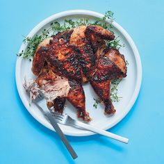 Cook your spatchcock chicken in the kitchen or on the braai. Marinating the chicken overnight in the yoghurt makes it super-tender.Recipe and styling by Claire FerrandiPhotograph by Dylan Swart Spatchcock Chicken, Rib Bones, Turkey Dishes, Chicken Livers, Yum Food, Gluten Free Chicken, Marinated Chicken, Kos, Claire