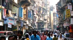 In older areas of Mumbai, India, homes have one room for living and sleeping, a…