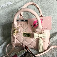 """NEW Luv Betsey Mini Bag Blush """"mini barell"""" bag from Betsey Johnson. Synthetic leather with embroidered mini heart design. Handles and optional Crossbody strap with gold hardware. Cutest bow & tassel!! Betsey Johnson Bags Mini Bags"""