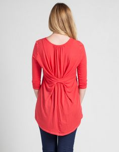 Flaunt your style sense in this trendy featherweight tunic featuring an unexpected back pleat, Kimono-style sleeves, and flattering asymmetric hem.