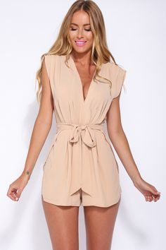 It's the playsuit of the season and we are head over heels in love with it! The stunning Thanks Officer Playsuit is a cool V-neck style with delicate pleating all over. There is a waist tie to highlight your curves and the shorts are layered for a fabulously flowy look. The fabric is slightly textured. Pair your look with a trendy statement necklace and closed toe pumps for an on-point look!  Pleated playsuit. Partly lined. Cold hand wash only. Model is standard XS and is wearing XS. True...