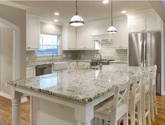 White cabinets, grey subway tile backsplash and bellingham-esqe countertop