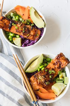 ThisSpicy Salmon Poke Bowl is a quick 20-minute meal that's an easy healthy dinner. A spicy cooked salmon fillet is served in a bowl of rice and fresh farmers market veggies for a protein-packed meal infused with Asian flavors.