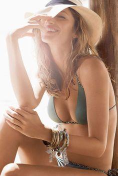 Gisele Bundchen... Sporting an olive green string bikini! Love her~