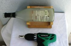 The best way to drill a hole in a wine bottle to fill with Christmas lights for a night light!