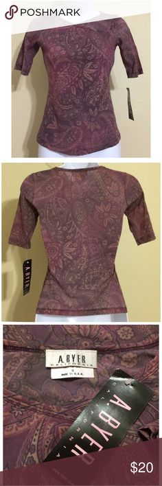 A. Byer California Top Size M A. Byer Blouse Size M Purple Color Paisley Pattern Short Sleeve Criss Cross Collar Hand Wash 100% Nylon Armpit to Armpit Approx. 14 Inches Length From Rear Collar Approx. 20 Inches Shoulder Approx. 12 Inches New With Tag.   Please check measurements to ensure proper fit A. Byer Tops Blouses