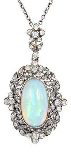 *Edwardian Opal Diamond Pendant, Edwardian 14 karat yellow gold and sterling silver opal and diamond pendant.