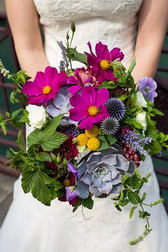{{Locally grown summer wedding bouquet with succulents, billy balls, echinops, cosmos, lavender, mint.}} Photography by Greenhouse Loft Photography, greenhouseloft.com || flowers by Pollen, pollenfloraldesign.com