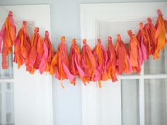 DIY: Fabric Tassle Bunting (No Sew!) --- This is an easy and gorgeous way to decorate a room or add some festivity to a celebration. Using scraps of fabric makes it a nice cleanup for your sewing stash too!