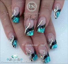 Teal, black, and clear nail art