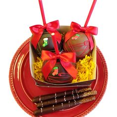 Delight you hostess this Christmas with this delectable basket with 3 chocolate caramel apples & 3 chocolate covered pretzels lovingly decorated by Chocolate Rain Shop.