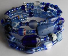 Memory Wire Bracelet: Big, Deep Blue Lampwork Glass Beads on Silver Oval Wire by VineDesignBeads
