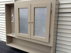 Remedy for ugly outside electric meters - Houzz Saffer Utility Cupboard, Porch Doors, Outdoor Cover, Outdoor Projects, Houzz, Furniture Making, Curb Appeal, Bathroom Medicine Cabinet, Outdoor Living
