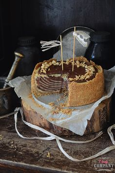 Creamy peanut butter zebra cheesecake on graham crust, with chocolate ganache and peanuts