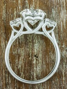 Hetty June I love this ring. If only it was a princess cut. Hetty June I love this ring. If only it was a princess cut. Heart Engagement Rings, Three Stone Engagement Rings, Three Stone Rings, Bling Wedding, Wedding Bands, Dream Wedding, Wedding Ring, Stone Heart, Brilliant Diamond
