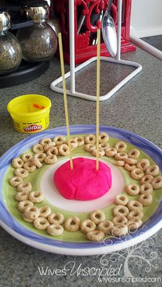 How many cheerios can you stack in 30 sec? So fun and great for fine motor skill development!