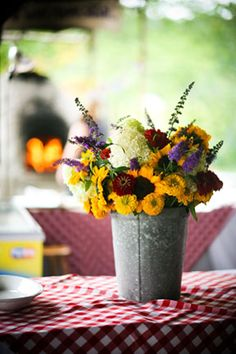 Add a pop of color with a galvanized bucket with bright blooms.