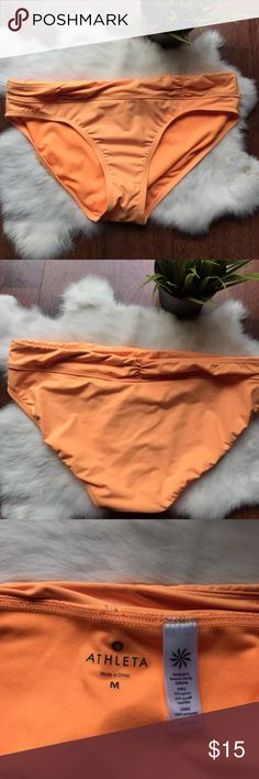 Athleta Woman Size M Swimwear Bikini Bottom Athleta Woman Size M Swimwear Bikini Bottom Solid Orange Triangle Bikini  Type: Woman Swimwear  Style: Woman Bikini Bottom  Brand: Athleta  Material: Nylon, Spandex, Polyester  Color: Neon Orange  Condition: Pre-owned, good condition. See pictures for more details. Pet and smoke free. Athleta Swim