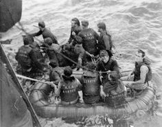 Survivors of the minesweeper HMCS Clayoquot, which was torpedoed by the German submarine U-806, being rescued by the corvette HMCS Fennel off Halifax, December 24, 1944.