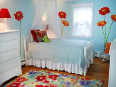 Bedroom: Poppy Flower Wall Art For Girls Bedroom. oversized floral wall decal. blue bedroom for girls. floral patterned rug. wood flooring. blue bedding.
