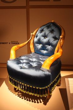 Silk satin upholstery covers the seat of the chair, made from horns, oak, brass and Tiffany glass balls.