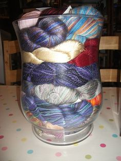 Yarn storage - Clear glass containers show colors, too, for added decoration!