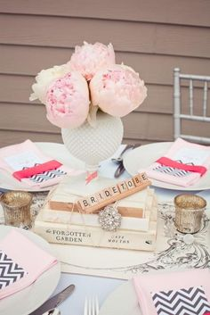 love the idea of books as part of the centerpiece & scrabble pieces to name the tables!