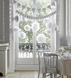 White bunting and pompoms - look really wintery without actually being winter themed!