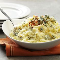 Oh snap! Yes please! Blue Cheese-Garlic Potatoes!! More Thanksgiving Side Dishes: http://www.bhg.com/recipes/entertaining/dinner/squash-potatoes-and-carrots-as-side-dishes/