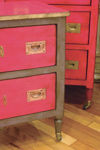 Paint drawers and top same color, edge and pulls same color, body another color. pink campaign dresser.