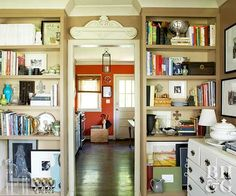 Some vintage apartment buildings come with gorgeous built-ins, ideal for storing modern necessities. If your apartment is lacking, fake the look by flanking a doorway with identical bookcases that reach almost to the ceiling and install moldings around the tops of the shelves. As a style bonus, paint the bookcase before installation, or line the backs with pretty paper.