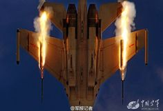 Chinese PLAAF Shenyang J-11 undercarriage photo firing missiles, [411x646]