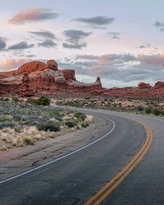 """""""If you find a path with no obstacles it probably doesn't lead anywhere."""" - Frank A. Clark  _  Driving through Arches National Park at sunset a few days ago. Could this be one of the most gorgeous landscapes in the USA? I've got more photos from Arches... Do you want to see them?  _  Just over 1 month is left on our epic 1-year #motherofallroadtrips around the US & Canada. But we're saving the best for last with the Grand Circle coming up (which covers Arizona New Mexico Utah and Nevada)…"""