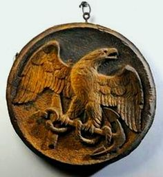 carved eagle - possible porthole cover.