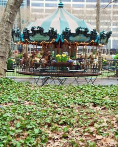 Bryant Park New York City Photograph - Bryant Park Carousel. Original photograph print from New York City featuring the whimsical carousel in Bryant Park. A lush print in greens and turquoise, this image is available in a variety of standard sizes and finishes. Sold unframed and does not include mat.