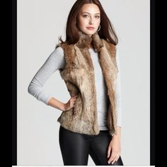 Vintage 100% Rabbit Fur Vest Sz L. Vintage 100% Rabbit Fur Vest Sz L. This was a gift given to my mom in the 1970s. It is zip closure. Has side pockets. Never worn b/c it was too small. This would fit a medium more comfortably. Please if interested message me. I will put up measurements and add more pics. Price is negotiable. Vintage Jackets & Coats Vests