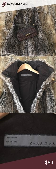 Sale 🎉🎁 ZARA lined faux fur coat vest size M Faux fur vest feels warm like a coat long enough to cover your thighs and bum has hidden hook closures on front with skinny grey belt and 2 hidden pockets. Love this would keep but I just don't wear it as much anymore now this I'm running around with the kids. Zara Jackets & Coats Vests