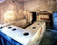 A thermapolium. What is that wall painting at the far end for?