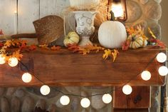 Jennifer Lutz's Fall Decorating Ideas for Your Mantel: Make it glow with lights.