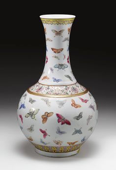 A 'FAMILE-ROSE' 'BUTTERFLY' VASE  XUANTONG MARK AND PERIOD