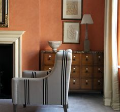 Chest of drawers and cool striped armchair.