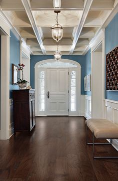 Just look at the combination of this PERGO Max Chocolate Oak engineered hardwood floor and these fun blue walls!