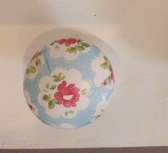 Cupboard Knobs With Cath Kidston Paper- these would be on my wardrobe door and main door of my room and they would create an inexpensive though effective vintage Cath Kidston atmosphere around my room.