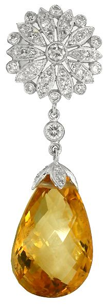 This is a gorgeous 14k white gold citrine and diamond pendant inspired from the Art Deco period