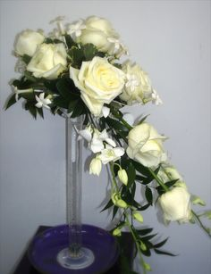 for the more traditional bride - cascading bouquets are actually making a comeback! orchids, roses, and stephanotis