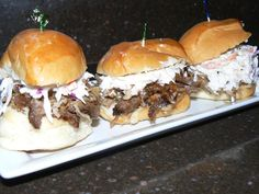 Smoke Roasted Pork Burr, Creamy Cole Slaw, and a Drizzle of House Barbecue Sauce on an Egg Slider Bun