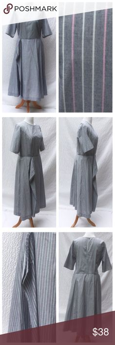 """New Eshakti Striped Fit Flare Modest Dress 24W New Eshakti gray, pink & white striped fit & flare midi dress 24W Measured flat: underarm to underarm: 49"""" Waist: 44"""" Length: 52"""" Sleeve: 13 1/2"""" Eshakti size guide for 24W bust: 51"""" Princess seamed bodice, side hidden zipper, back keyhole opening w/rouleau button closure. Seamed waist, flared midi skirt w/side  flounced ruffle. Lined in cotton voile. Cotton, cross-dyed pinstripe, no stretch. Machine wash. New w/cut out Eshakti tag to prevent…"""