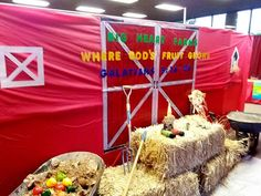 Big Heart Farms, VBS, 2015, decor ideas, barn, straw, This red table cover wall is missing the vertical black (Sharpie) lines to create the wood slats (barn) effect.